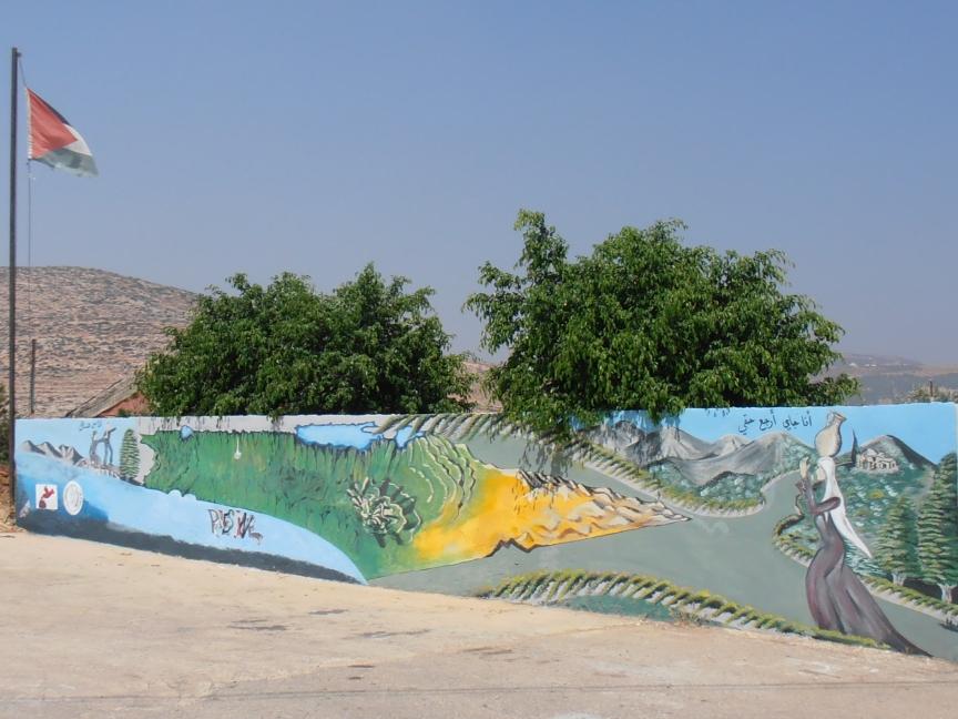 Mural on Concrete Wall in Al Aqaba. Photo by Kali Rubaii.
