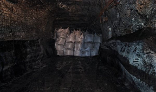 Figure 17. Cleaning up after a gold mine in Greenland that operated from 2004-2013. The white mega bags are full of oil polluted soil and will be kept in the mine's abandoned gallery for eternity. Soil remediation would have required shipping of the heavy load to Esbjerg, Denmark, around 3000 kilometres away. This option was not considered worthwhile. Photo by Nathalia Brichet.